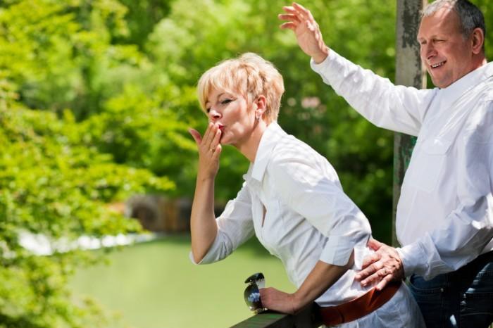 Happy-senior-couple-on-bridge-waving-hands-000012718287_Small