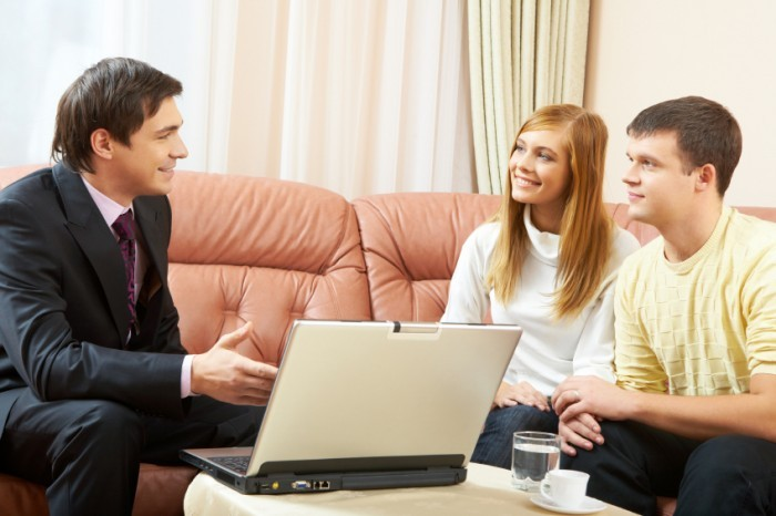 Portrait of a businessman interacting with young couple