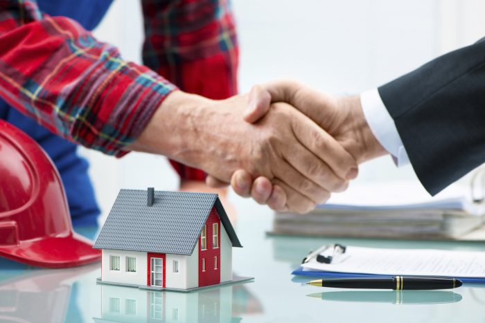 Handshakes with customer after contract signature