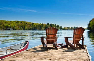 Dock chairs and canoe on the lake
